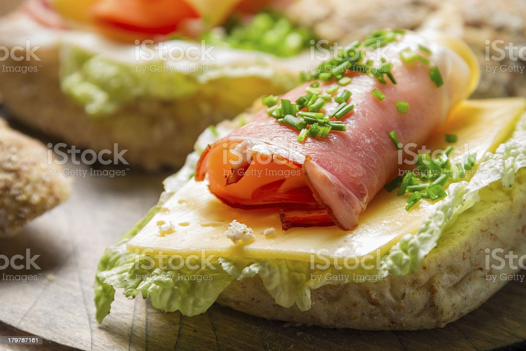 Fresh sandwich with lettuce, cheese and ham royalty-free stock photo