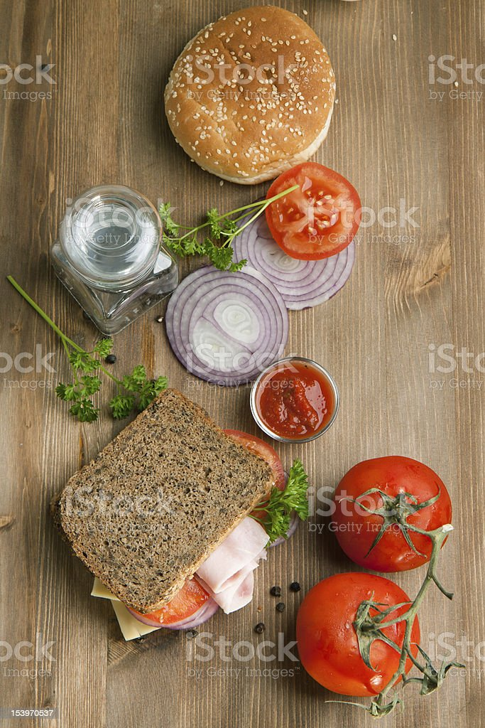 Fresh sandwich with tomatoes, onion and ketchup royalty-free stock photo