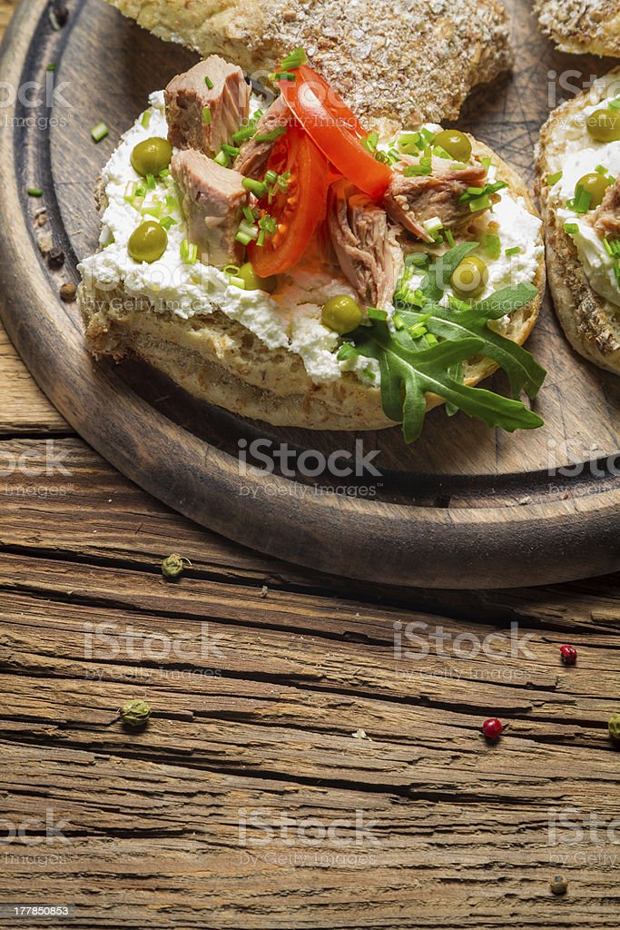 Fresh sandwiches on a old wooden cutting board background 2 royalty-free stock photo