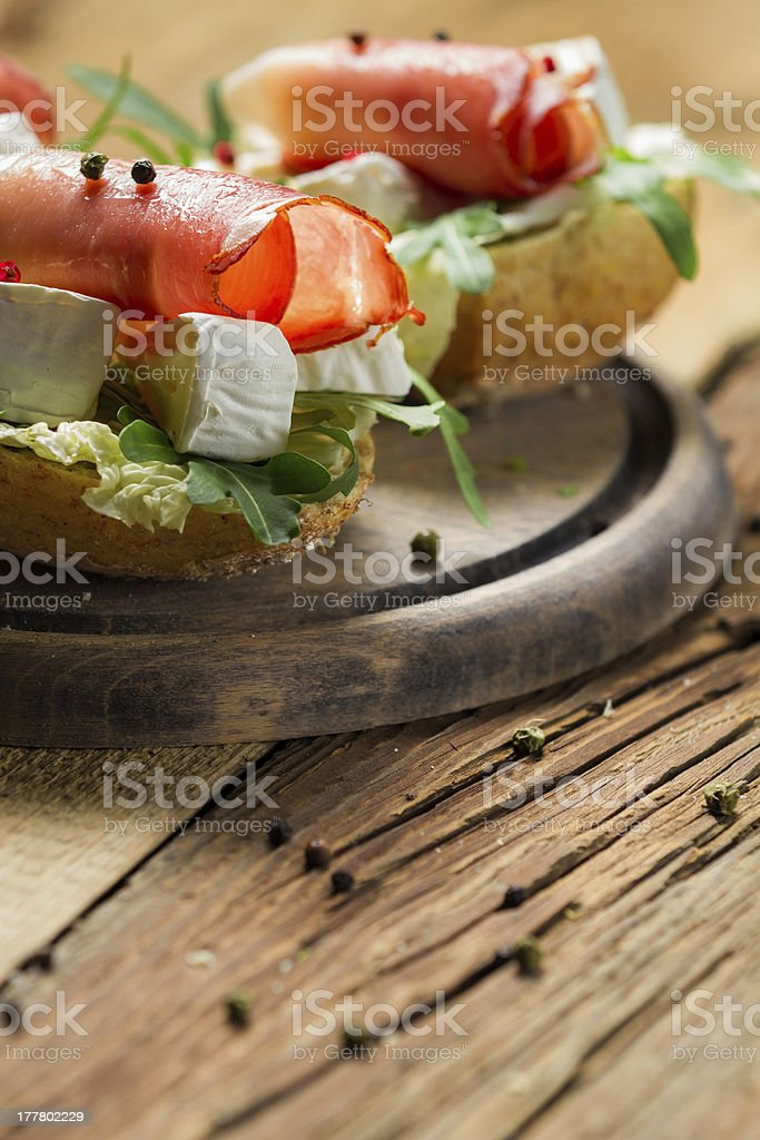 Fresh sandwiches on a old wooden cutting board background royalty-free stock photo
