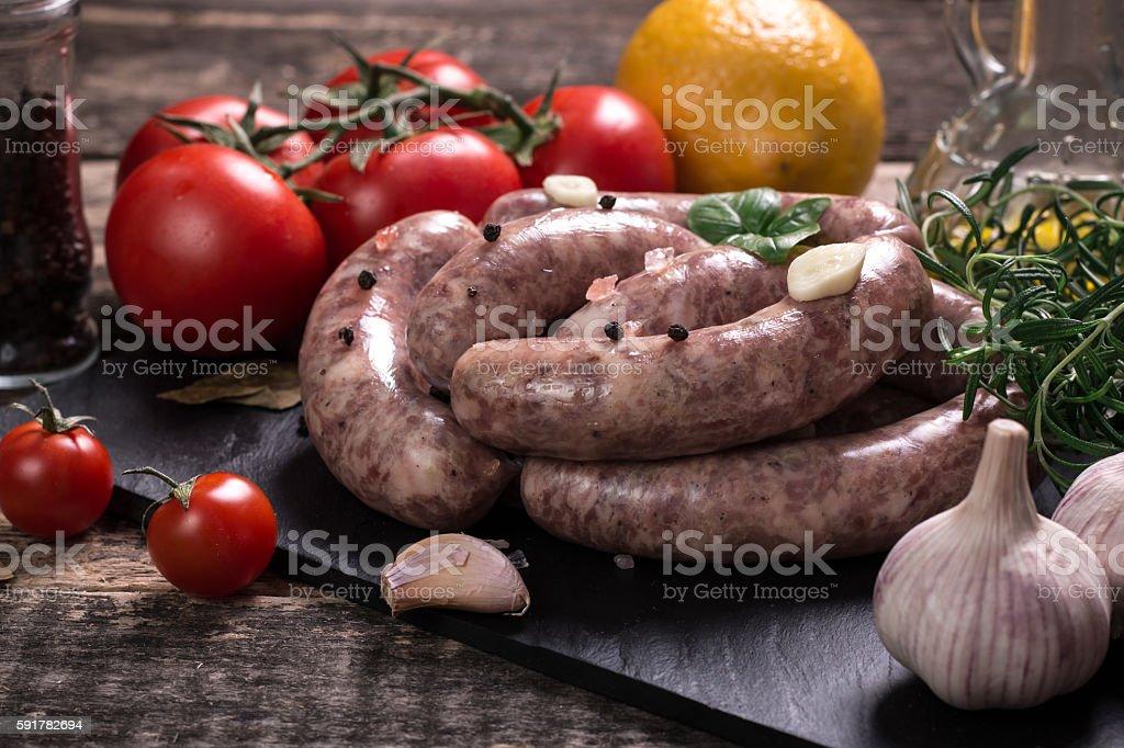 Fresh sausage  assortment garnished with fresh rosemary stock photo