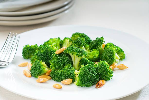fresh sauteed broccoli and almonds stock photo