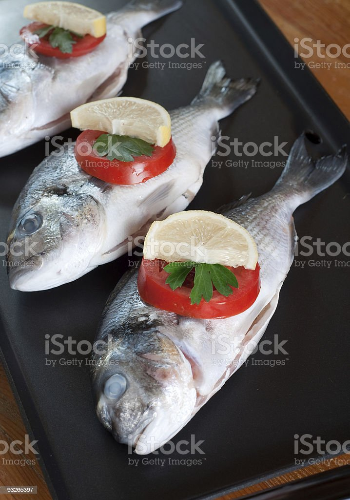 fresh sea bream with vegetables royalty-free stock photo