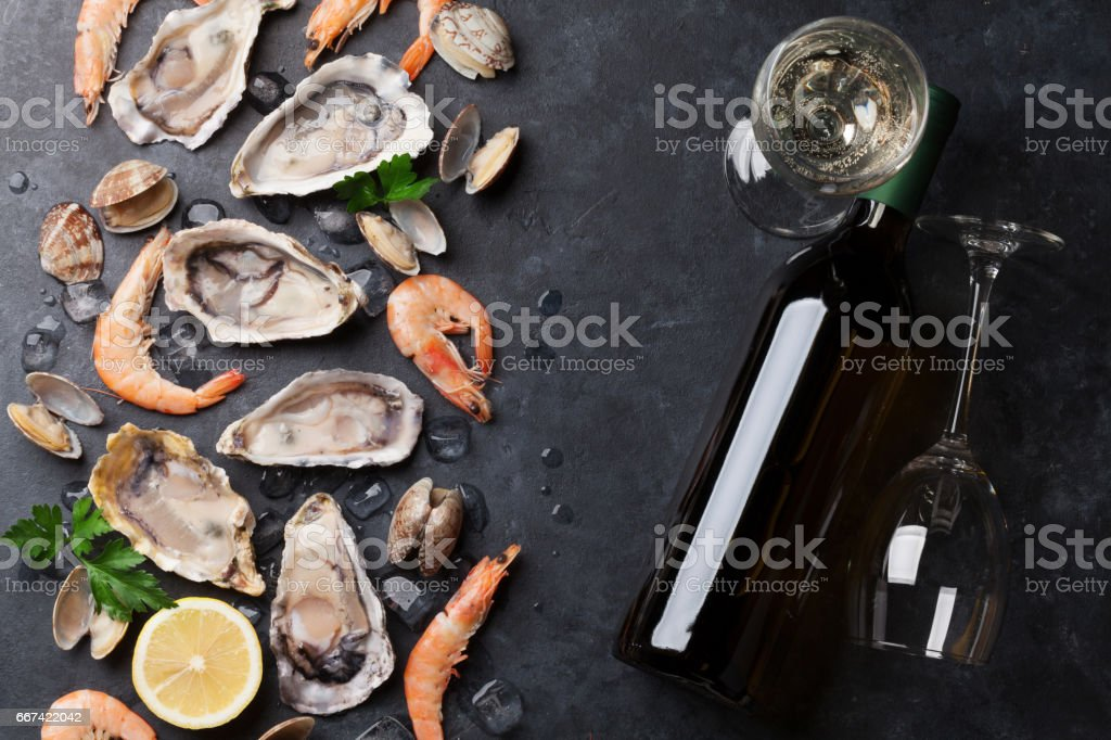 Fresh seafood and white wine stock photo