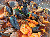 Fresh seafood clams, mussels and prawns, close up