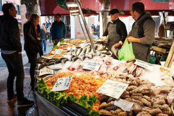 Fresh seafood in fish market in Venice, Italy Venice, Italy - April, 3, 2019: Fresh seafood in fish market in Venice, Italy mercato stock pictures, royalty-free photos & images