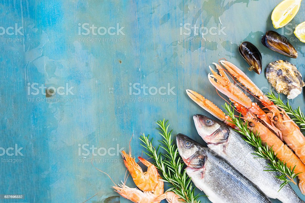 Fresh seafood on blue background stock photo
