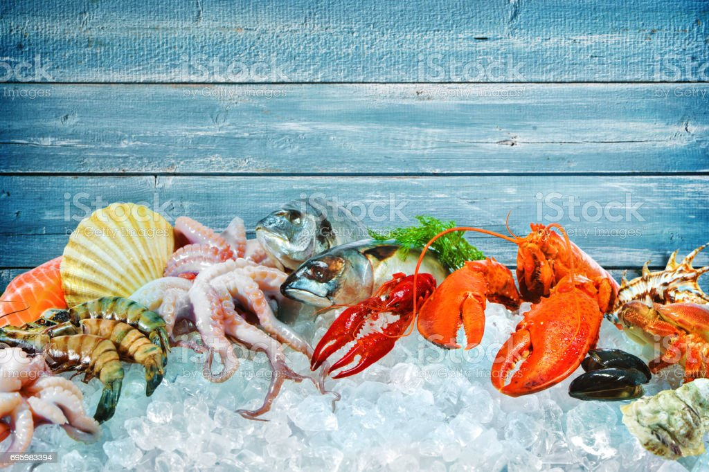 Fresh seafood on crushed ice stock photo