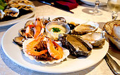 istock Fresh seafood platter with lobster, shrimps and oysters on the table 1281934143