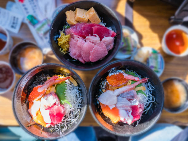 Fresh seafood rice bowl (Kaisen-don) - Japanese Rice with sashimi of tuna, Maguro, Otoro, salmon, squid and ikura Fresh seafood rice bowl (Kaisen-don) - Japanese Rice with sashimi of tuna, Maguro, Otoro, salmon, squid and ikura tokyo stock pictures, royalty-free photos & images