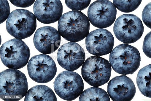 670420880istockphoto Fresh selected blueberries isolated on white background. Top view pattern 1164727107