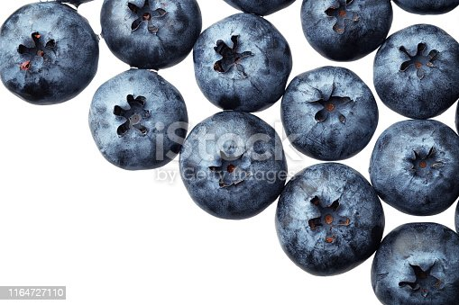 670420880istockphoto Fresh selected blueberries isolated on white background. Top view pattern 1164727110