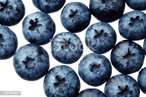 670420880istockphoto Fresh selected blueberries isolated on white background. Top view pattern 1167362677