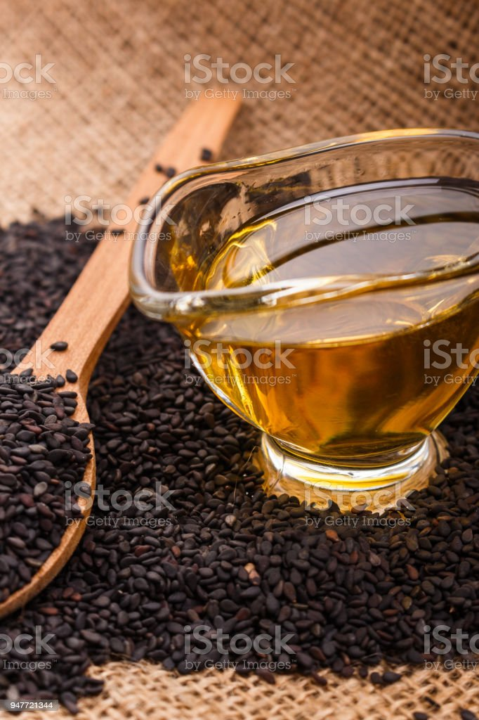 fresh sesame seeds on a rustic background stock photo