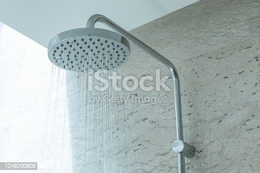 808471266 istock photo Fresh shower with water drops splashing. Faucet in modern bathroom. 1248200805