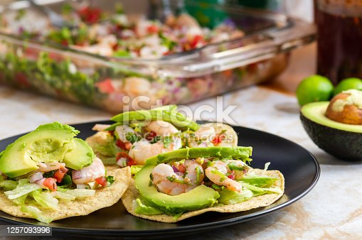 Delicious, freshly made shrimp ceviche. Shrimp marinated in lime juice with fresh vegetables served on tostadas, a kind of crispy tortilla