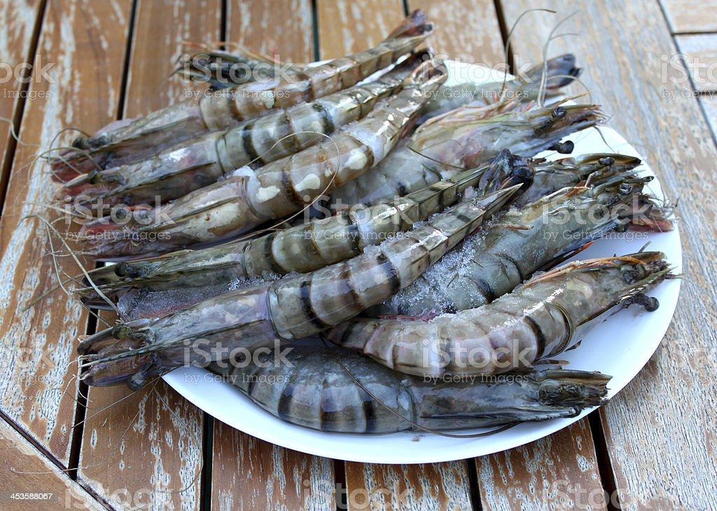 Fresh Shrimp in a plate on the garden table. royalty-free stock photo