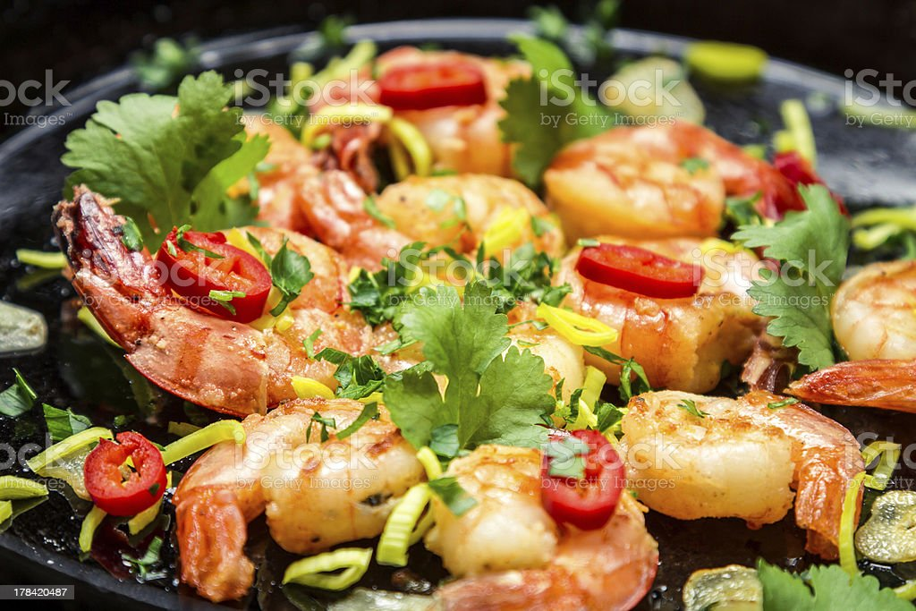 Fresh shrimps on old pan with garlic royalty-free stock photo