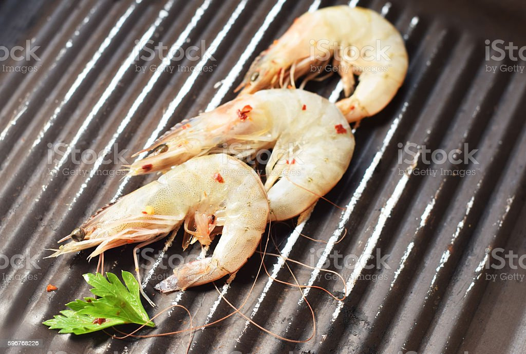 Fresh shrimps on the grill stock photo