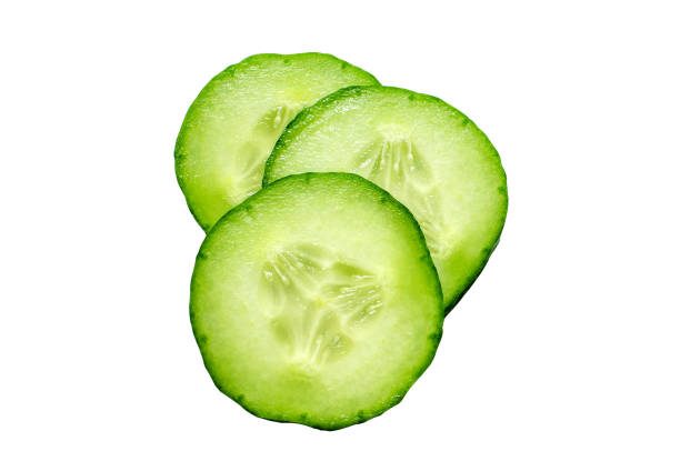 fresh slice cucumber isolated on white background - cucumber stock photos and pictures