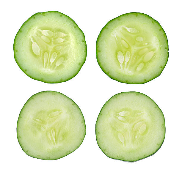 fresh slice cucumber on white background - cucumber stock photos and pictures