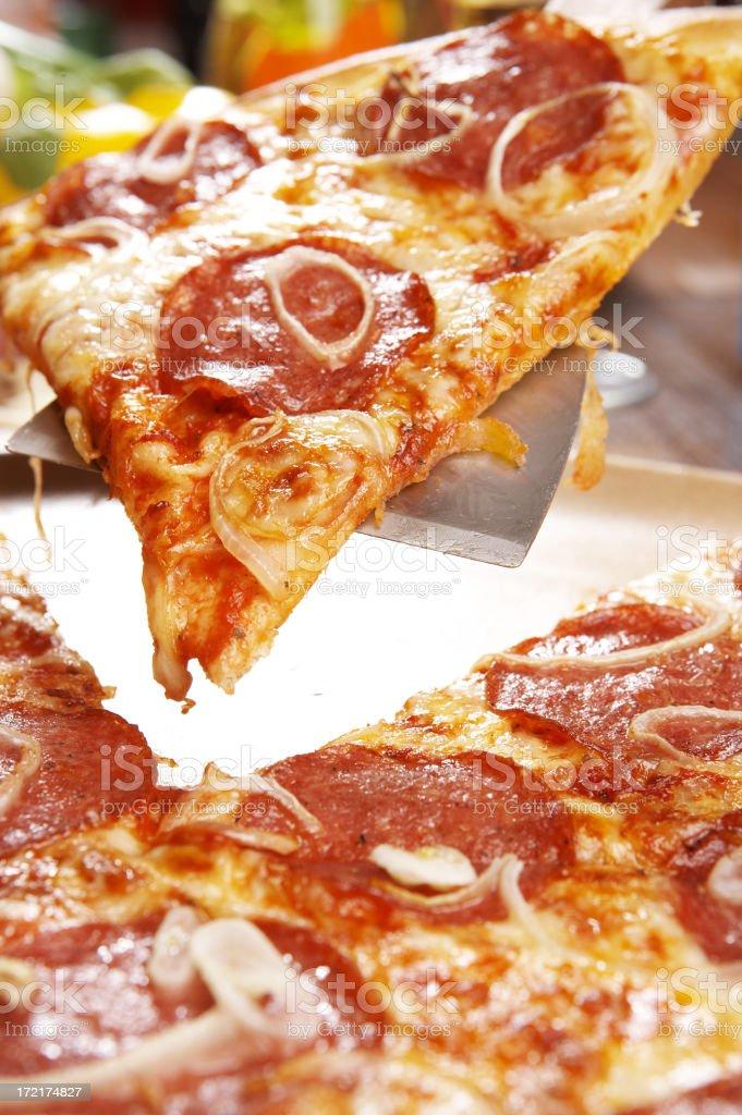 Fresh slice of pepperoni pizza royalty-free stock photo