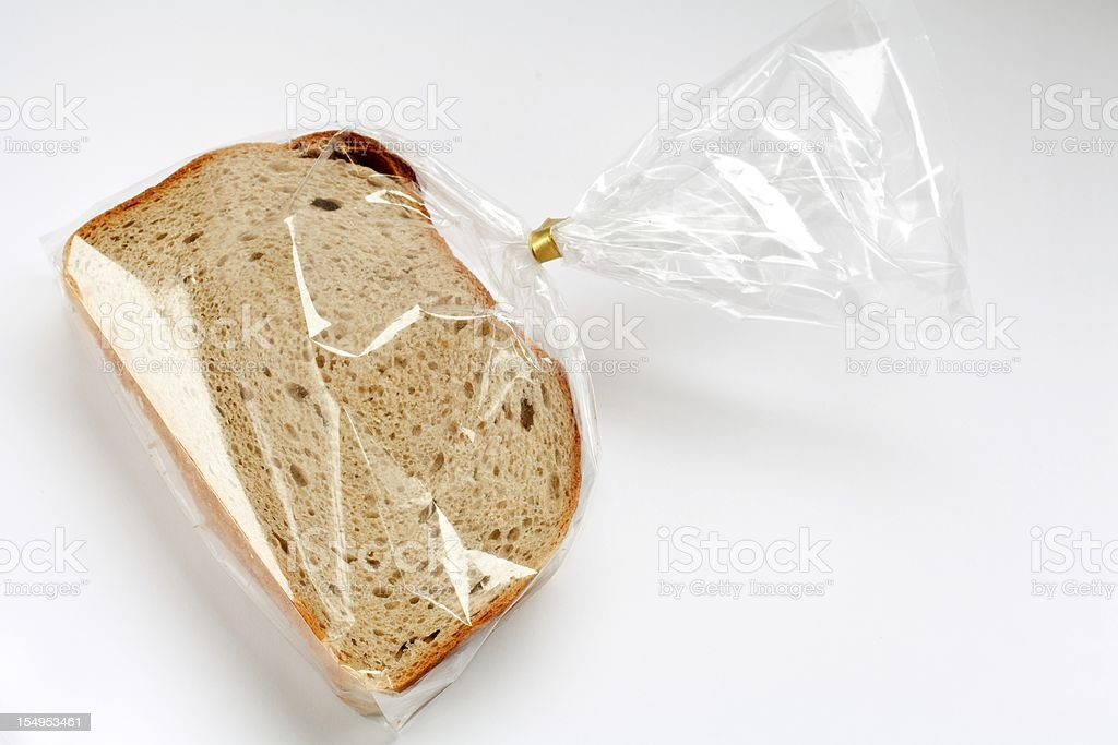 fresh sliced bread in transparent plastic folie  on white stock photo