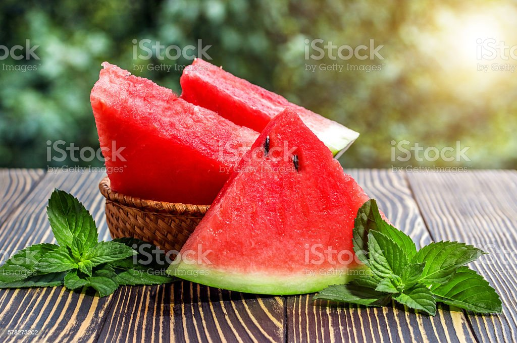 Fresh sliced watermelon wooden background stock photo