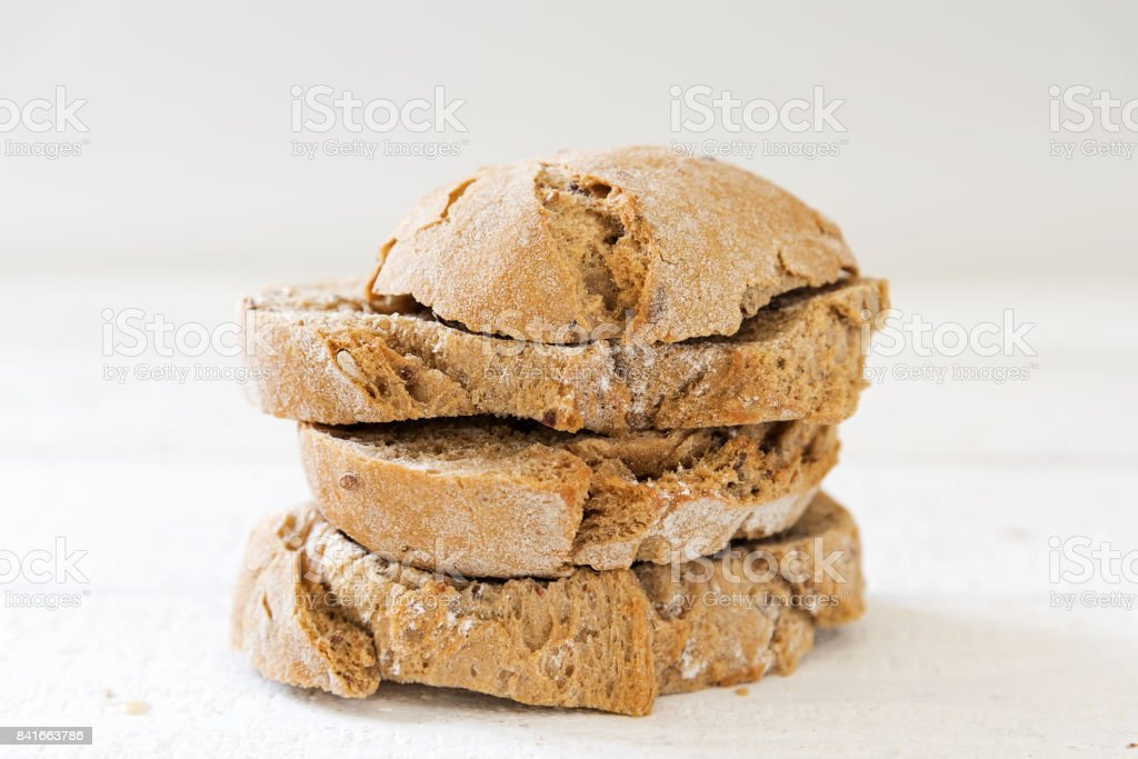 Fresh Sliced Wholemeal Bread In A Pile Light Gray Background