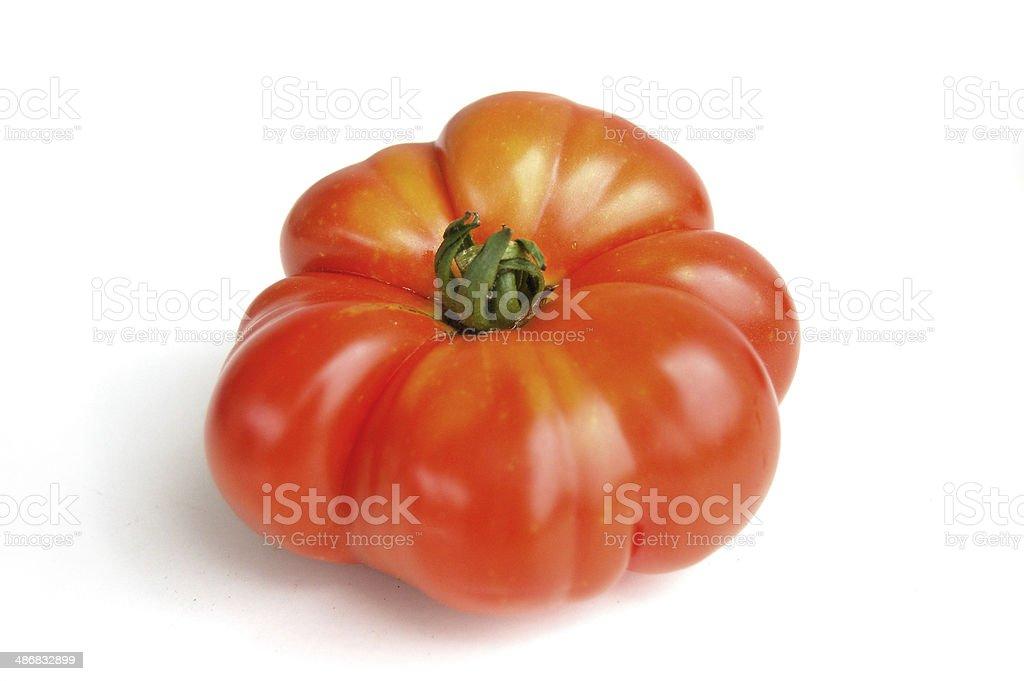 Fresh slicing tomato, isolated stock photo