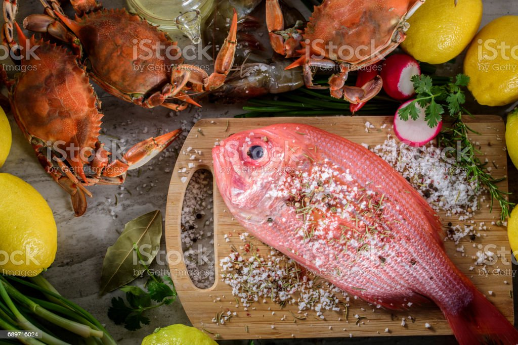 Fresh Snapper with Salt and Spices stock photo