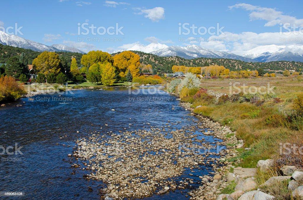 Fresh Snow on a Rocky Mountain Autumn Landscape stock photo