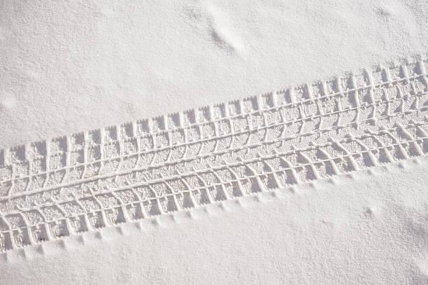 Fresh snow sedan tire track Sedan car tire track in fresh snow tire track stock pictures, royalty-free photos & images
