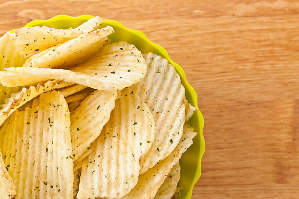 fresh sour cream and onions potato chips fresh sour cream and onions potato chips sour cream stock pictures, royalty-free photos & images