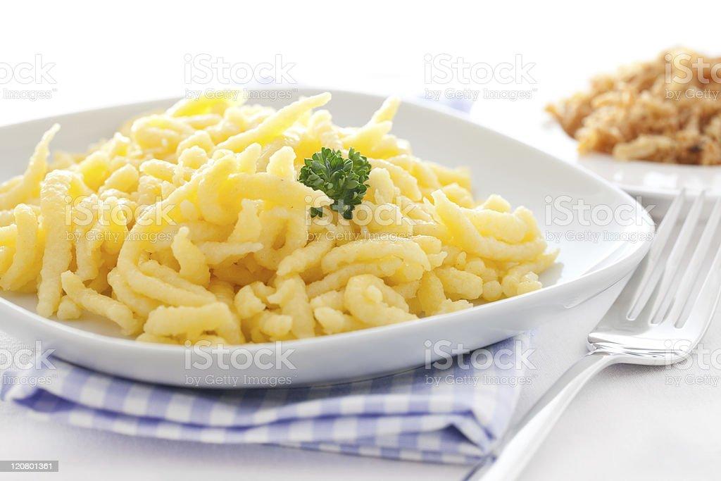 fresh spaetzle on a plate stock photo