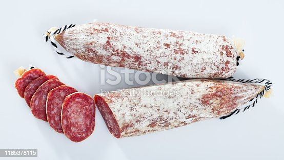 Fresh spanish longaniza sausages cut in slices on a white surface, close-up