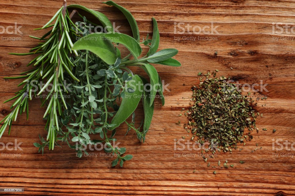 Fresh spice herbs on rustic wood stock photo