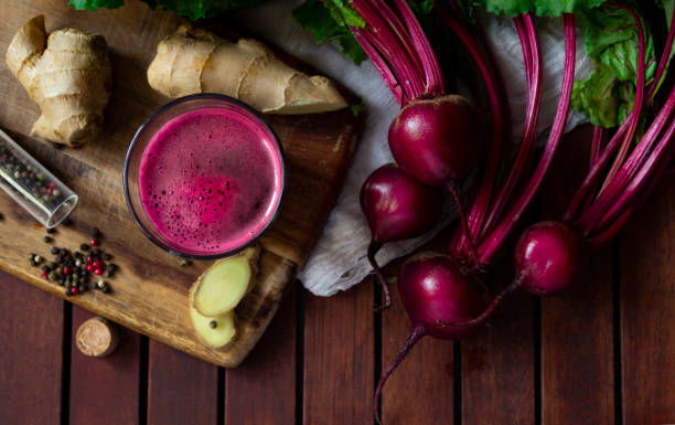 Fresh spicy beetroot juice with Ginger, flat lay fresh spicy beetroot juice with Ginger on wooden table, flat lay beet stock pictures, royalty-free photos & images