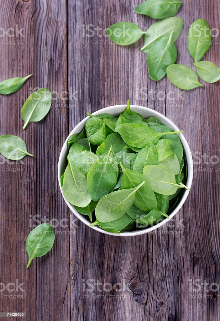 Fresh spinach in bowl stock photo
