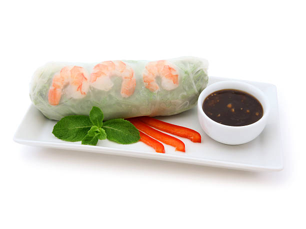 Fresh Spring Roll Fresh Vietnamese Shrimp Spring Roll with peanut dipping sauce isolated on white (excluding the shadow) vietnamese culture stock pictures, royalty-free photos & images