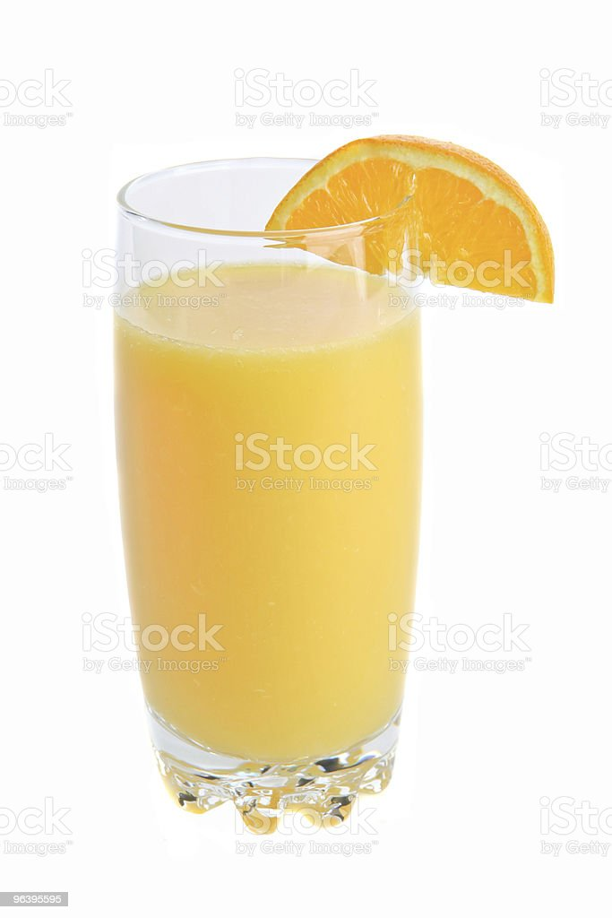 Fresh squeezed glass of orange juice with an orange wedge - Royalty-free Color Image Stock Photo
