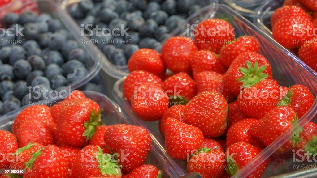 Fresh strawberries and blueberries stock photo