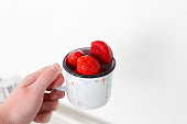 Fresh strawberries in a cup. In the kitchen.