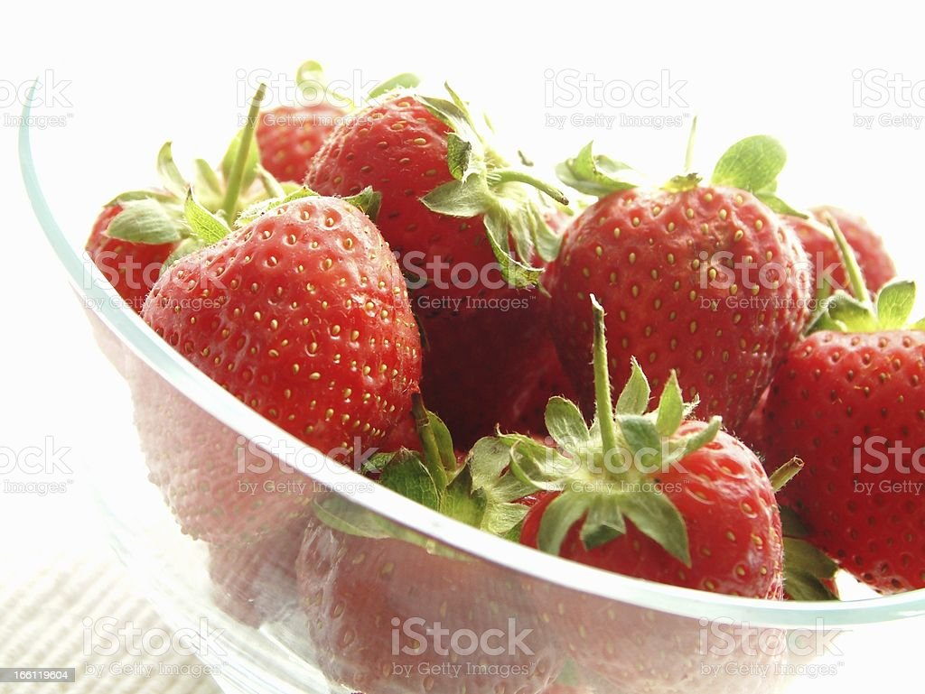 fresh strawberries in glass bowl on white background royalty-free stock photo