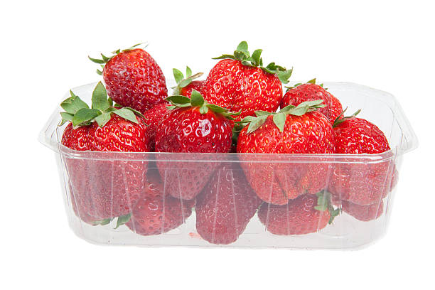 Fresh strawberries in plastic box, isolated on white Fresh strawberries in plastic box, isolated on white fruit carton stock pictures, royalty-free photos & images