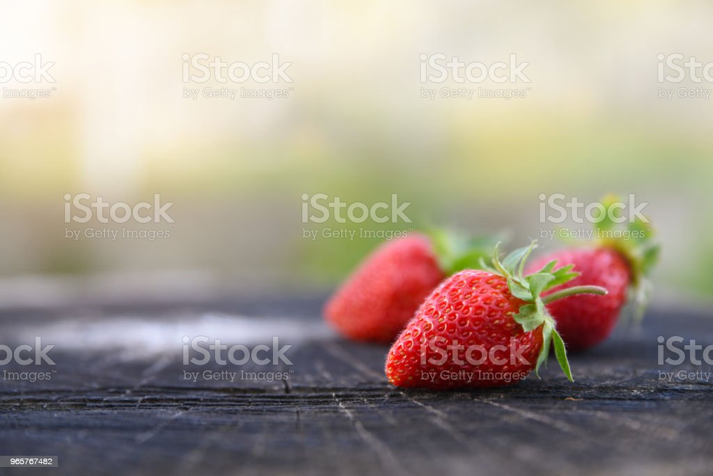 Fresh strawberries lies on oak stump, side view, copy space for the text - Royalty-free Berry Stock Photo