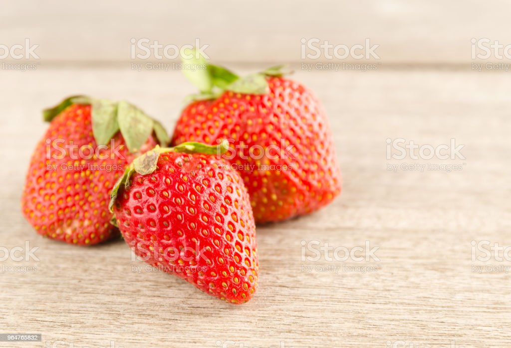 Fresh strawberries on old wooden background royalty-free stock photo