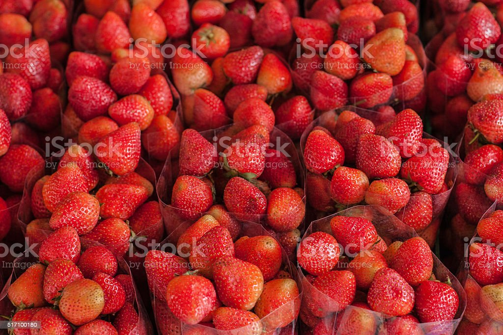Fresh strawberries on the local market stock photo
