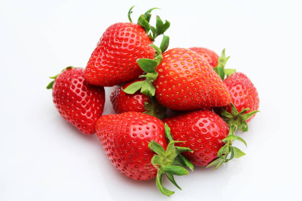 fresh strawberries on white background - strawberry imagens e fotografias de stock