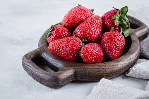 Fresh Strawberries On Wooden Plate On White Table Background Summer Berries Copy Space Top View Stock Photo - Download Image Now
